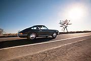 Slate gray 1966 Porsche in the Mojave Desert, California, American west coast