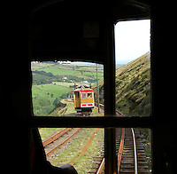 Snaefell Mounatin Railway. Snaefell is Isle of Man's highest mountain, 621 m, and seven kingdoms can be seen from the mountain peak: Mann, Scotland, England, Wales, Ireland, Heaven and the Sea. It is possible to take a ride on the only electric maountain railway in the British Isles to the top. the Railway was build in 1895....