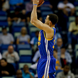 Mar 18, 2013; New Orleans, LA, USA; Golden State Warriors point guard Stephen Curry (30) shoots against the New Orleans Hornets during the first quarter a game at the New Orleans Arena. The Warriors defeated the Hornets 93-72. Mandatory Credit: Derick E. Hingle-USA TODAY Sports