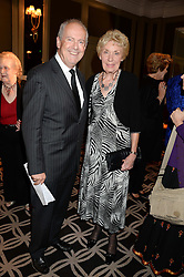 GYLES BRANDRETH and JOAN MORECAMBE widow of Eric Morecambe at the 90th birthday party for Nicholas Parsons held at the Hyatt Churchill Hotel, Portman Square, London on 8th October 2013.