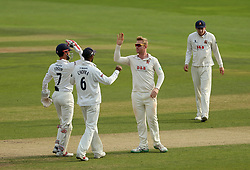 Essex's Simon Harmer celebrates with teammates after bowling out Yorkshire's Andy Hodd (not in picture) for an LBW by during day three of the Specsavers County Championship, Division One match at the Cloudfm County Ground, Chelmsford.