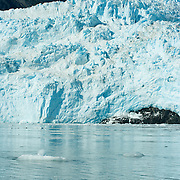 Aialik Glacier meets the waters of Aialik Bay in Kenai Fjords National Park Alaska