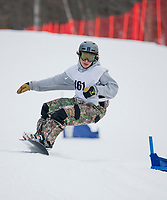 Matt Bartelli of Vermont Academy charges the snowboarding course during Wednesday afternoon racing at Gunstock.  (Karen Bobotas/for the Laconia Daily Sun)