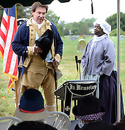 "SHANNAH08P<br /> Euell Aira Nielsen (right) of Lansdowne, Pennsylvania, portraying Hannah Till, and Samuel Davis (left) of Chesterfield, New Jersey portraying George Washington addresses the crowd during a dedication ceremony honoring Hannah Till Saturday October 3, 2015 at Eden Cemetery in Collingdale, Pennsylvania. Hannah Till, a free black woman and unsung hero of the Revolutionary War who worked for Gens. George Washington and Lafayette is being honored as a ""Patriot"" by the Daughters of the American Revolution with a special ceremony and headstone dedication at Eden Cemetery, a historically-black cemetery in Collingdale. (William Thomas Cain/For The Inquirer)"
