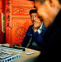 A Chinese man plays mahjong in a small village just outside of Dali, in the Yunnan province of China. (Photo/Scott Dalton)