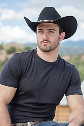 portrait of a handsome cowboy outdoors