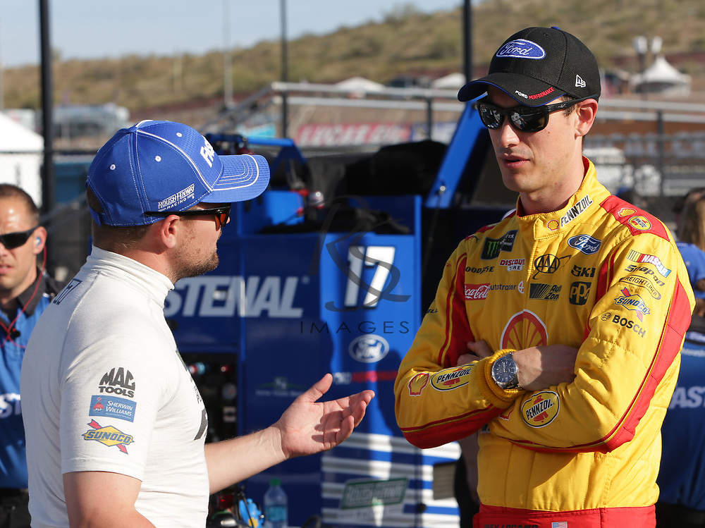 Ricky Stenhouse Jr. and  Joey Logano before qualifying for Sunday's NASCAR Cup Series auto race on Friday, March 17, 2017, in Avondale, Ariz.  (AP Photo/Rick Scuteri)