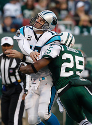 Nov 29, 2009; East Rutherford, NJ, USA; Carolina Panthers quarterback Jake Delhomme (17) is hit after he throws by New York Jets safety Kerry Rhodes (25) during the second half at Giants Stadium. The Jets defeated the Panthers 17-6.