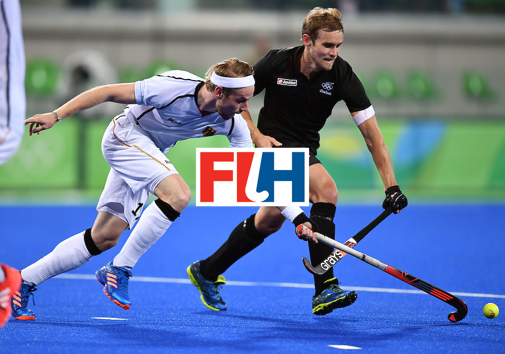 Germany's Christopher Ruhr (L) vies with Germany's Florian Fuchs during the men's quarterfinal field hockey Germany vs New Zealand match of the Rio 2016 Olympics Games at the Olympic Hockey Centre in Rio de Janeiro on August 14, 2016. / AFP / MANAN VATSYAYANA        (Photo credit should read MANAN VATSYAYANA/AFP/Getty Images)
