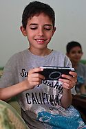 Anass playing with his Playstation portable before lunch.