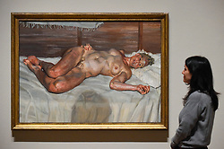 "© Licensed to London News Pictures. 23/10/2019. LONDON, UK. A staff member views ""Flora with Blue Toenails"", 2000-01, by Lucien Freud. Preview of ""Lucian Freud: The Self-portraits"" at the Royal Academy of Arts in Piccadilly.  56 works on display chart Freud's artistic development over almost seven decades on canvas and paper in a show which runs 27 October to 26 January 2020.  Photo credit: Stephen Chung/LNP"