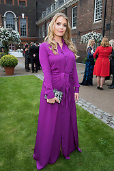 Lady Kitty Spencer attends Historic Royal Palaces Kensington Palace Summer Party to raise money for the Royal Ceremonial Dress Collection, hosted in partnership with Harpers Bazaar US Editor Glenda Baile at Kensington Palace, London, June 30th 2016.