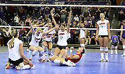 Washington's Jordan Larson slams the ball as Nebraska's blocks the hit during the NCAA Div. 1 regional women's volleyball in Seattle on Saturday, Dec. 13, 2008. (AP Photo/Kevin P. Casey)