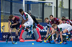 Surbiton's Arjan Drayton-Chana takes evasive action as Steven Ebbers of Wimbledon looks to find a foot. Wimbledon v Surbiton - Men's Hockey League Final, Lee Valley Hockey & Tennis Centre, London, UK on 23 April 2017. Photo: Simon Parker