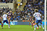 Ipswich Town midfielder Jonathan Douglas (22) has a header towards goal during the EFL Sky Bet Championship match between Reading and Ipswich Town at the Madejski Stadium, Reading, England on 9 September 2016. Photo by Mark Davies.