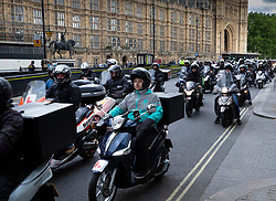 VIDEO AVAILABLE https://we.tl/t-mpReKtMDIB © Licensed to London News Pictures. 28/05/2019. London, UK. Food delivery drivers sound their horns as the head to Parliament Square in protest at the murder of a colleague. A 46 year old man has died of his injuries after trying to stop a group of males stealing his moped in Battersea, south west London on Saturday night. Photo credit: Peter Macdiarmid/LNP