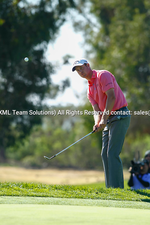 February 7, 2015:  Harris English chips on to the 6th green on the Torrey Pines Golf Course during the third round of the Farmers Insurance Open in San Diego, Ca.