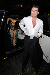 Simon Cowell and Mezghan Hussainy attend My Beautiful Ball held at the Landmark Hotel in London, UK. 11/04/2013<br />BYLINE MUST READ : GOTCHAIMAGES.COM<br /><br />Copyright by © Gotcha Images Ltd. All rights reserved.<br />Usage of this image is conditional upon the acceptance <br />of Gotcha Images Ltd, terms and conditions available at<br />www.gotchaimages.com