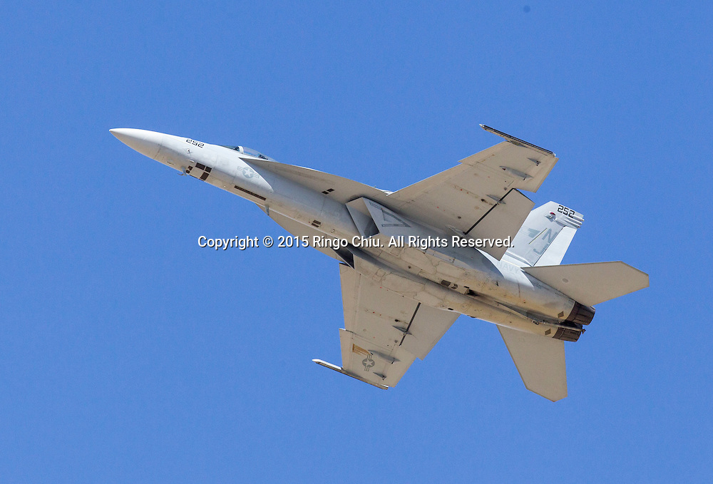 An U.S. Navy F/A-18 Super Hornet performs during Los Angeles County Air Show, in Lancaster, California on March 21, 2015. (Photo by Ringo Chiu/PHOTOFORMULA.com)