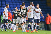 Bolton Wanderers midfielder Neil Danns  and Bolton Wanderers forward Shola Ameobi  during the Sky Bet Championship match between Bolton Wanderers and Brentford at the Macron Stadium, Bolton, England on 30 November 2015. Photo by Simon Davies.