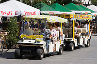 Golf cart tour guides on Market square Krakow Poland