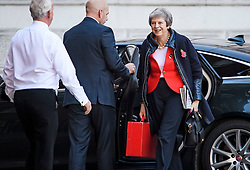 © Licensed to London News Pictures. 29/10/2018. London, UK. British Prime minister THERESA MAY is seen smiling as she arrives at Downing Street on the day that Chancellor Philip Hammond will present his Budget to Parliament. This will be the last budget before the UK is due to exit the European Union in March of 2019. Photo credit: Ben Cawthra/LNP