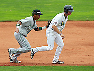 LumberKings shortstop Bryan Brito (9) tags out Kernels designated hitter Zach Wright (5) during the game between the Clinton LumberKings and the Cedar Rapids Kernels at Veterans Memorial Stadium in Cedar Rapids on Monday, September 3, 2012.