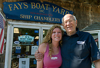 Merrill Fay with his granddaughter Lillian Fay outside of the ship chandlery at Fay's Boat Yard on Lake Winnipesaukee in Gilford, NH.  (Karen Bobotas/for New England Boating)