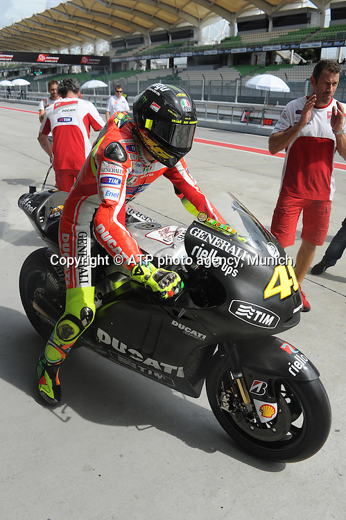 Moto Grand Prix. Sepang International Circuit. Malaysia.Thursday 2/2/ 2012. <br /> #46 Valentino Rossi (Ita) Team Ducati during the  2012 Pre Season Moto GP testing <br /> Moto Grand Prix 2012 - SEPANG Circuit, Malaysia near Kuala Lumpur . MotoGP class, motorcycle racing -  Motorrad GP - Fee liable image - copyright &copy; ATP Thinakaran SHANMUGAM