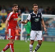 Millwall player Jack Powell keeps tight to Chesterfield player Jay O'Shea during the Sky Bet League 1 match between Millwall and Chesterfield at The Den, London, England on 29 August 2015. Photo by Bennett Dean.