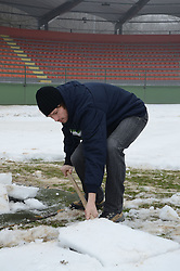 Fabijan Cipot, player of ND Mura 05 is cleaning the snow two days before match between ND Mura 05 and NK Olimpija in 22th Round of Prva liga NZS 2012/13, on March 1, 2013 in Fazanerija, Murska Sobota, Slovenia. (Photo by Ales Cipot / Sportida)