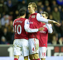 03.12.2011, DW Stadium, Wigan, ENG, Premier League, Wigan Athletic vs FC Arsenal, 14. Spieltag, im Bild Arsenal's captain Robin van Persie celebrates scoring the fourth goal against Wigan Athletic with team-mate Per Mertesacker and Aaron Ramsey // during the football match of english Premier League, 14th round between Wigan Athletic an FC Arsenal at DW Stadium, Wigan, ENG on 2011/12/03. EXPA Pictures © 2011, PhotoCredit: EXPA/ Sportida/ David Rawcliff..***** ATTENTION - OUT OF ENG, GBR, UK *****