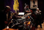 Composer and trumpeter John McNeil, Noah Preminger on Saxophone, drummer Rudy Royston and bassist Mike McGuirk perform at Puppet's Jazz Club on May 13, 2009 in Brooklyn New York. photo by Joe Kohen for The New York Times