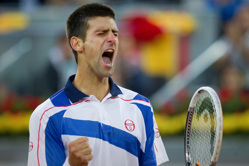 Novak Djokovic from Serbia celebrates during the match against Thomaz Bellucci from Brazil in the Madrid Open Tennis tournament in Madrid, Saturday, May 7, 2011.