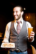 Taylor Holmes with Fox Liquor's homemade caramel corn and a dark and stormy.