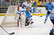 18 February, 2006 - Anchorage, AK:  Ace's goalie Matt Underhill guards the right post as he watches the battle for the puck in the corner during the Long Beach IceDogs victory over the Alaska Aces 4-1 at the Sullivan Arena.