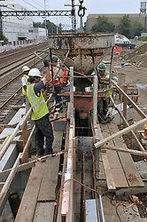 Concrete pouring of the platform. Additional View taken during Construction Progress Photography of the Railroad Station at Fairfield Metro Center - Site visit 12 of once per month Chronological Documentation.