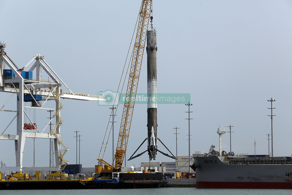 April 4, 2017 - Cape Canaveral, FL, USA - The historic SpaceX rocket booster is hoisted off a barge Tuesday, April 4, 2017 after it arrived back home around 7:00am to Port Canaveral in Cape Canaveral, Fla. This first stage rocket booster was flown once and reused and launched from Kennedy Space Center Pad 39A March 30, 2017 at 6:27pm carrying a SES 10 satellite and returned to land on a drone barge. (Credit Image: © Red Huber/TNS via ZUMA Wire)