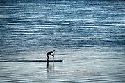 Paddle boarding in Chatham Harbor, Cape Cod, Massachusetts, USA.