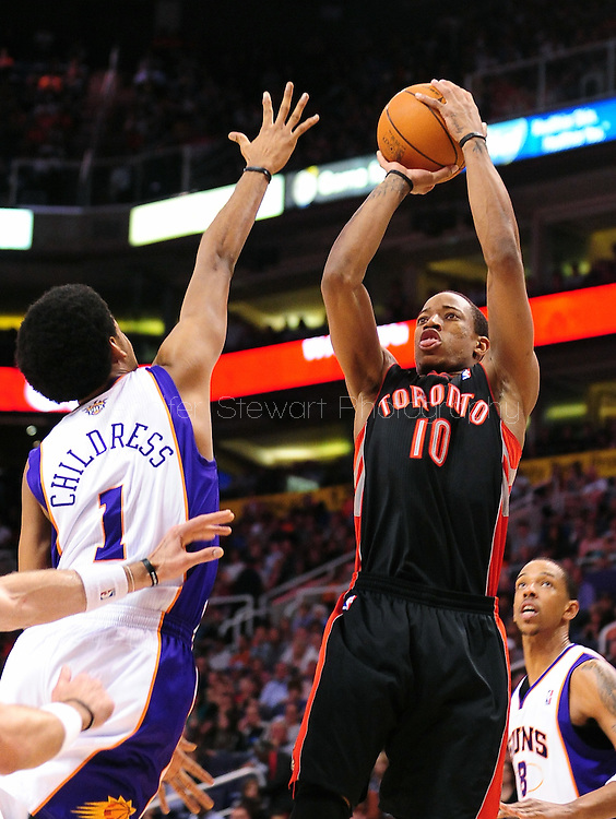 Mar. 23, 2011; Phoenix, AZ, USA; Toronto Raptors guard DeMar DeRozan (10) puts up a basket against the Phoenix Suns guard Josh Childress (1)  at the US Airways Center. Mandatory Credit: Jennifer Stewart-US PRESSWIRE