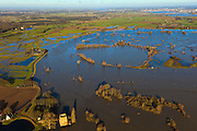 Nederland, Gelderland, Gemeente Voorst, 20-01-2011; IJssel bij hoogwater ter hoogte van de Nijenbeker Klei, Deventer aan de horizon. Onder in beeld Slot Nijenbeek (Kasteel Nijenbeek of Het Hooge Huis)..Castle Nijenbeek in the middle of the high waters of the river IJssel. The (Hanse) city of Deventer at the horizon (top right).luchtfoto (toeslag), aerial photo (additional fee required).copyright foto/photo Siebe Swart