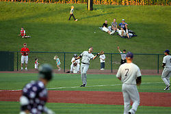 12 August 2011: Jake Eigsti, a natiive of Eureka Illinois, straddles the 3rd base foul line while tracking a high hit ball during a game between the Rockford River Hawks and the Normal Cornbelters at the Corn Crib in Normal Illinois.
