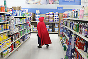 A woman dressed as Little Red Riding Hood works at the Hillsborough, North Carolina Walmart on Halloween 2012.