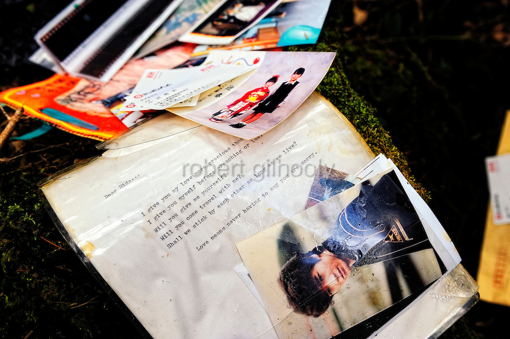 """A variety of personal belongings, including photos, letters and a fragment of Walt Whitman's """"Song of the Open Road,"""" are scattered among dead branches and moss-covered volcanic rock in Aokigahara Jukai, better known as the Mt. Fuji suicide forest, which is located at the base of Japan's famed mountain west of Tokyo, Japan."""