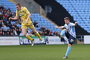 Coventry City defender Aaron Phillips (17)  with a shot  during the Sky Bet League 1 match between Coventry City and Millwall at the Ricoh Arena, Coventry, England on 16 April 2016. Photo by Simon Davies.