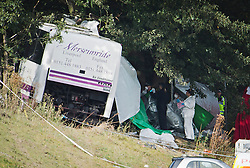 © London News Pictures. 11/09/2012. Hindhead, UK . Forensics working under a covered area next to the bus. The scene of a fatal bus crash on the north bound A3 motorway near Hindhead Tunnel, Hindhead, Surrey on September 11, 2012.Three people were killed and a number of others seriously injured when a coach carrying overturned after crashing into a tree. Photo credit: Ben Cawthra/LNP