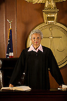 Female judge standing in court portrait