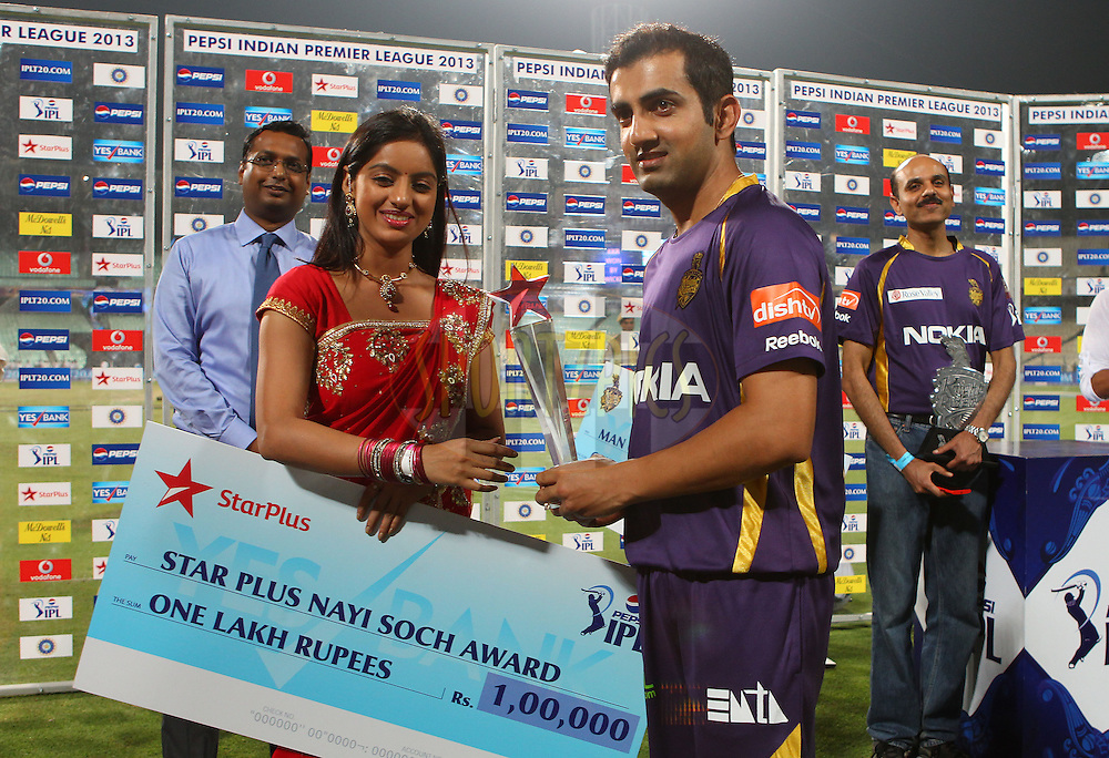 Gautam Gambhir is presented with the Star Plus Nayi Soch award during the opening match of the Pepsi Indian Premier League between the Kolkata Knight Riders and The Delhi Daredevils  held at the Eden Gardens Stadium in Kolkata on the 3rd April 2013..Photo by Ron GauntSPORTZPICS/IPL..Use of this image is subject to the terms and conditions as outlined by the BCCI. These terms can be found by following this link:..http://www.sportzpics.co.za/image/I0000SoRagM2cIEc