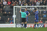 AFC Wimbledon defender Paul Robinson (6) is shown a yellow card, booked during the EFL Sky Bet League 1 match between Milton Keynes Dons and AFC Wimbledon at stadium:mk, Milton Keynes, England on 10 December 2016.