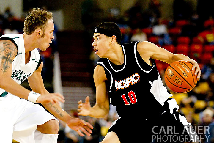 11/25/2006 - Anchorage, Alaska: Junior guard Solomon Horsechief (10) of the Pacific Tigers battles Junior guard Matt Gibson (2) of the Hawaii Warriors as Hawaii beat Pacific 71-60 to give the Warriors a third place finish in the 2006 Great Alaska Shootout<br />